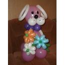 Розовый щенок с цветами