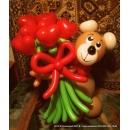 Мишка с букетом сердец
